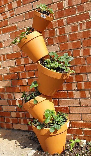How To Build A Tilting Clay Pot Garden Ehow Garden Pots Vertical Garden Planters Pool Landscaping