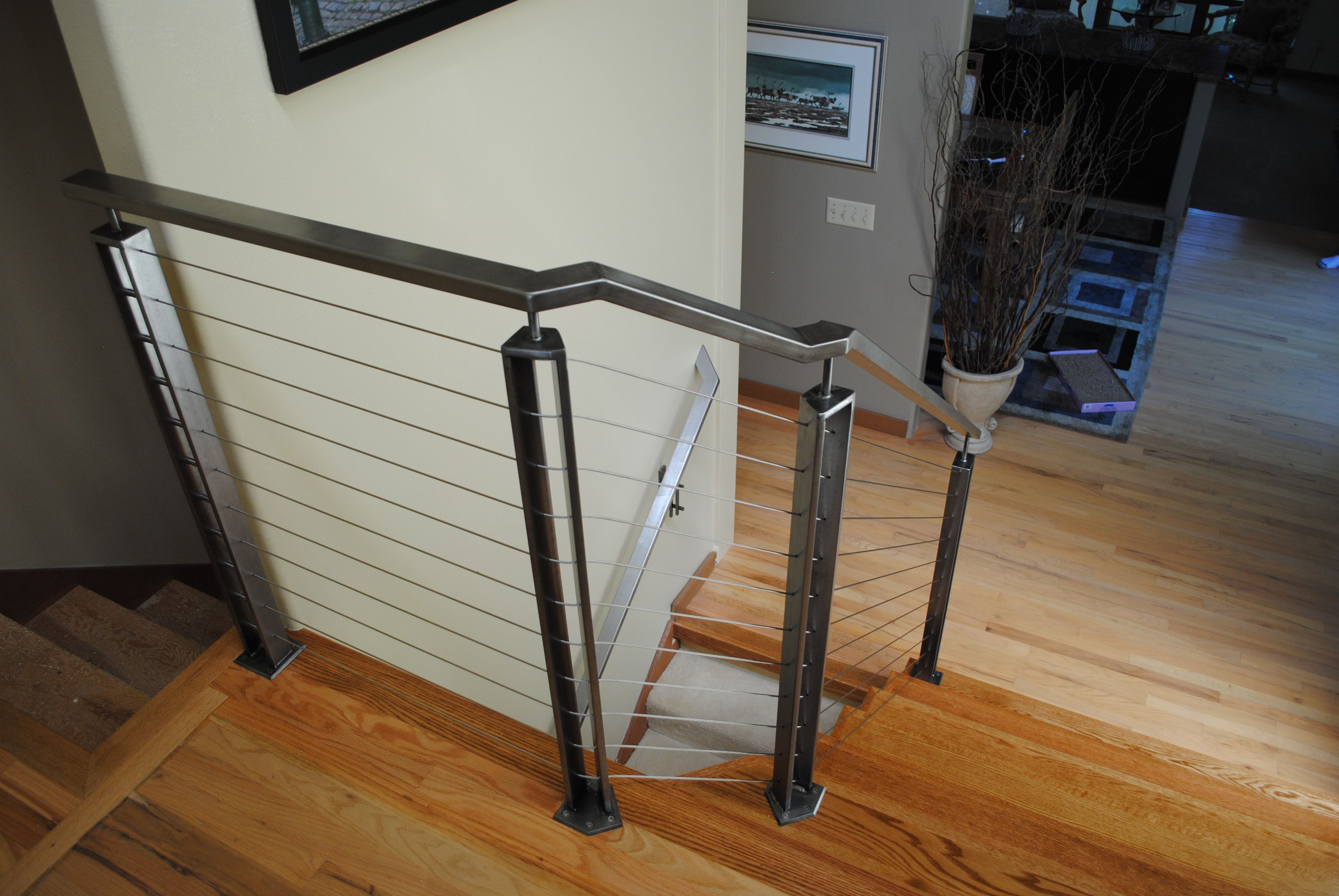 Elegant Application Of Galvanized Steel With Stainless Steel Cable Infill On A Wood Staircase Wood Staircase Steel Railing Wardrobe Rack