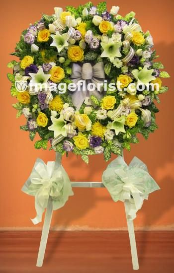 A Stunning Sympathy Ring Arrangement On Stand Of Mixed Lily Roses Chrysanthemum Please State Preferred F Condolence Flowers Online Florist Colorful Flowers