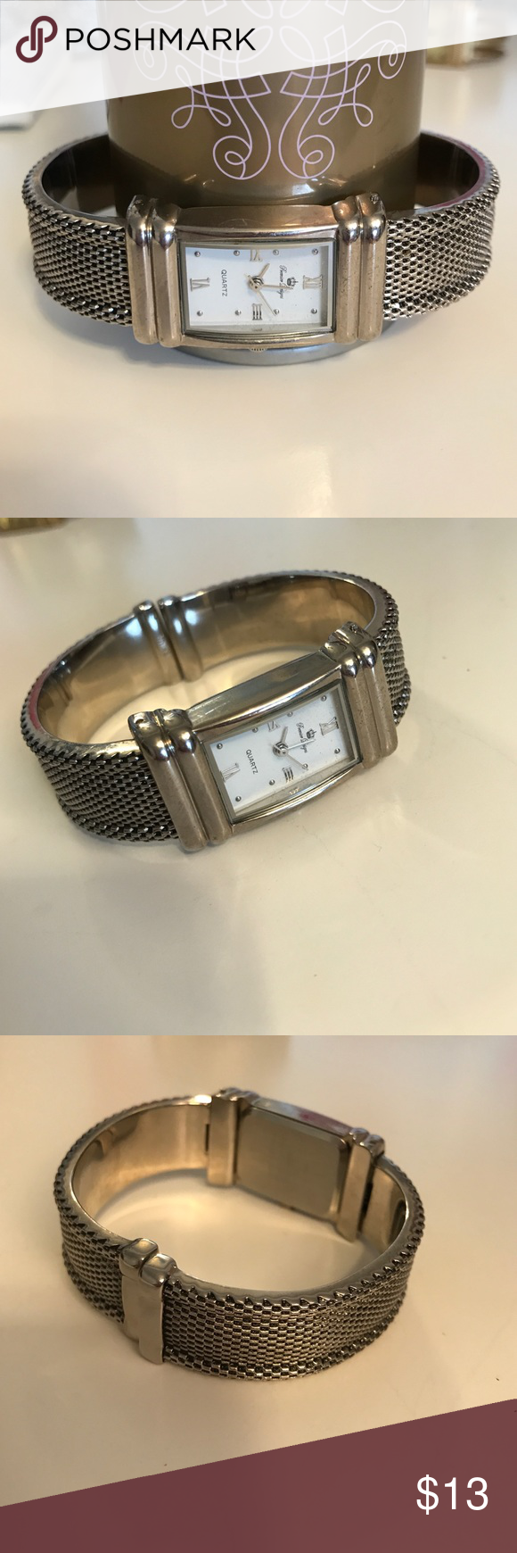 Silver watch Only worn a few times! In great shape! Let me know if you have any questions! This not not real silver, only the color. The watch also works but it needs batteries Premier Designs Accessories Watches