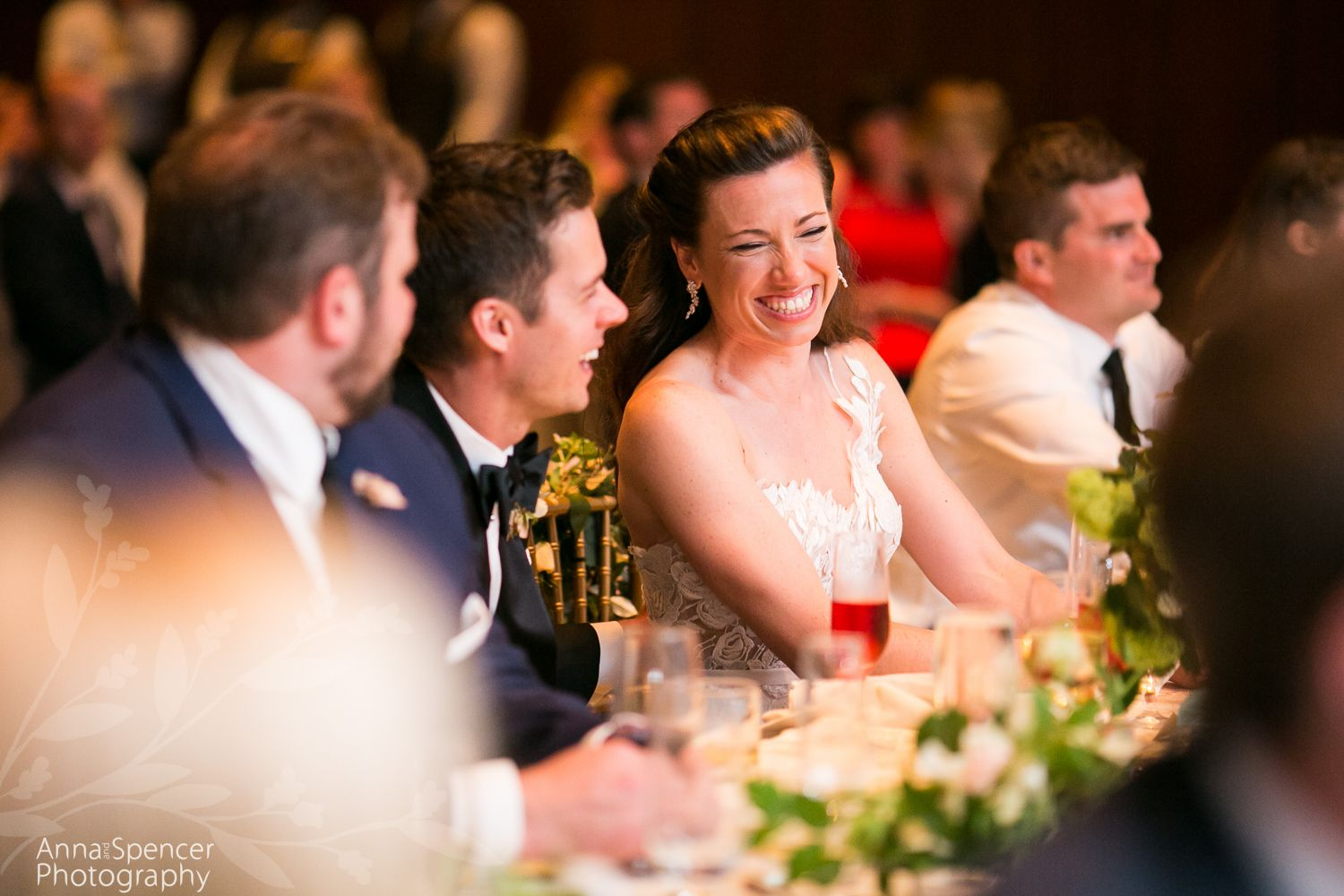 Bride and groom listening to toasts at their wedding reception
