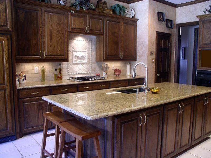 Best Giallo Ornamental Granite With Dark Cabinets Rectangular 400 x 300