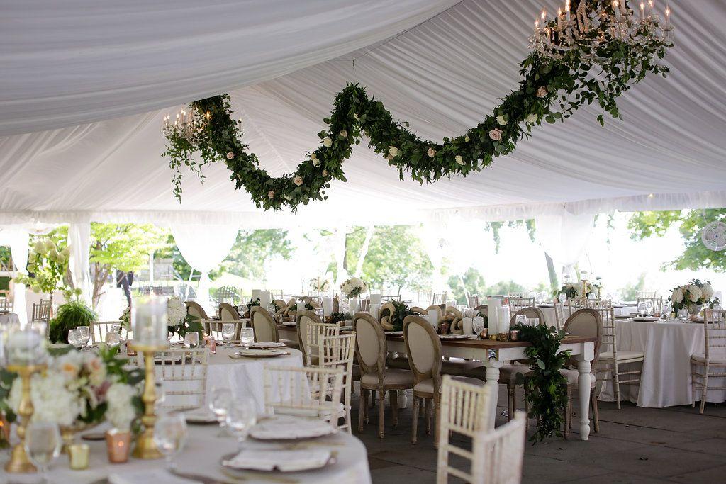 Photography: Clark + Walker Studio| Venue: The Inns of Aurora | Floral + Event Design: Stacy K Floral | #hangingflowers #weddinggarland #tentedwedding