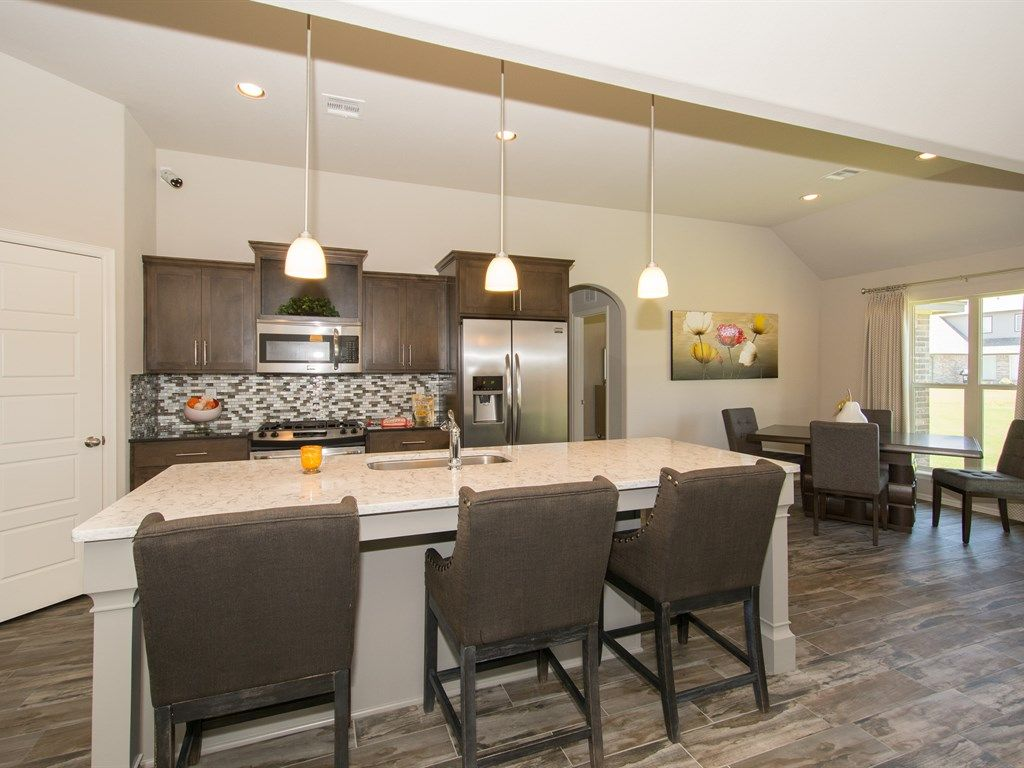 Bakersville Kitchen Gray Island With Dark Wood Cabinets Simmons Homes New Homes Tulsa Ok Kitchen De Kitchen Cabinet Colors Dark Wood Cabinets Home