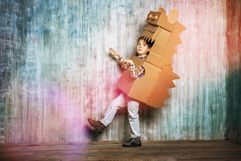 Dinosaur Little dreamer boy playing with a cardboard dragon dinosaur Childhoo