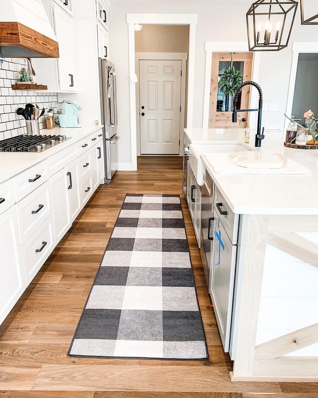Ruggable On Instagram Sierra Farmhouse Spices Up Her Kitchen With The Buffalo Plaid Black Runne White Kitchen Decor Black White Rug White Farmhouse Kitchens