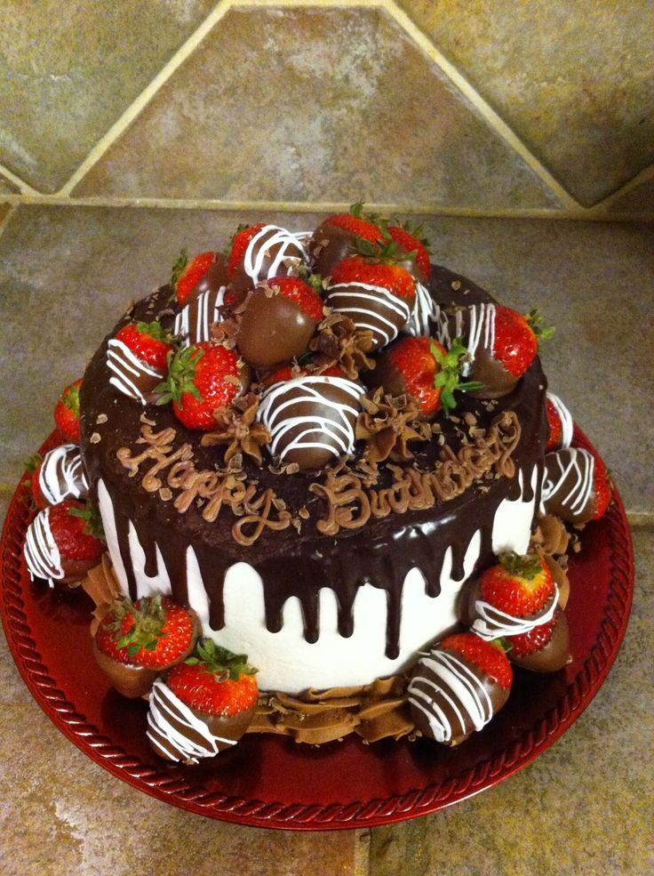 cake decorated with chocolate covered strawberries ...