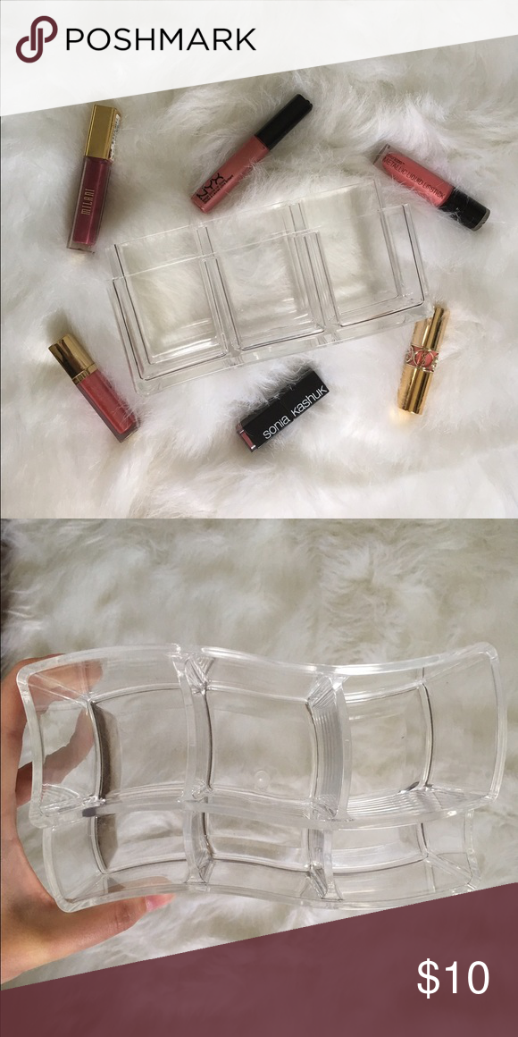 Acrylic Lipstick Organizer Gently used acrylic lipstick/gloss organizer. Perfect for vanity organization and on trend in the beauty world! The tag has been removed from the bottom, however the item is from the brand caboodles. Caboodles Makeup Lipstick