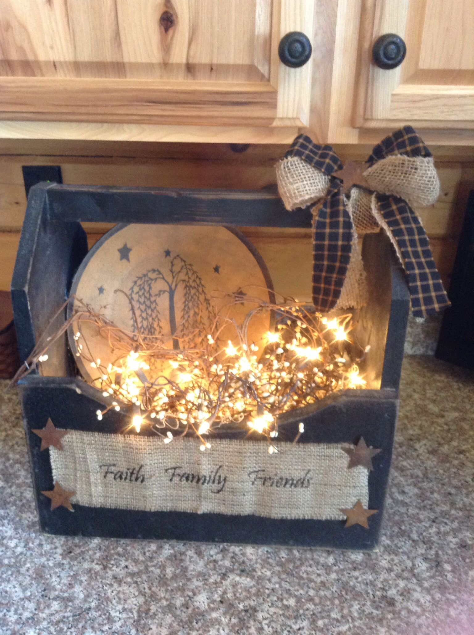 Old black primitive box with willow plate, berries and lights.
