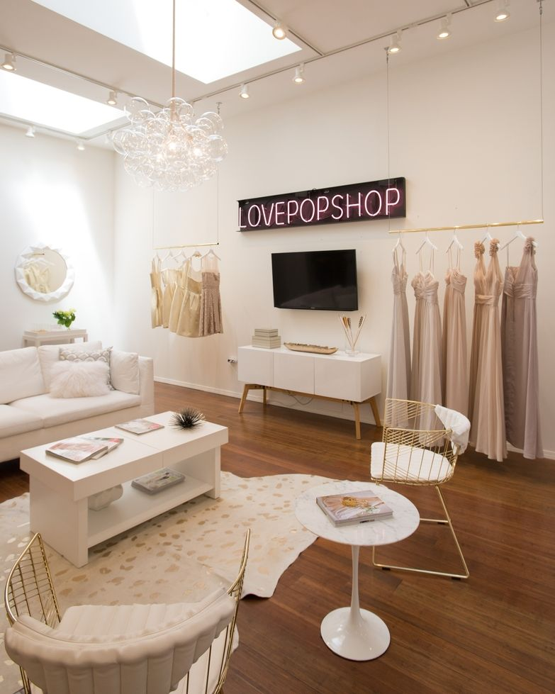 890c70619460 Decorist created this feminine, luxe bridal boutique design from an empty  conference room, on