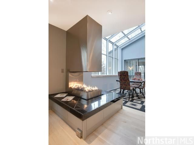 Modern Gas Burning Three Sided Fireplace In The Kitchen Dining Room