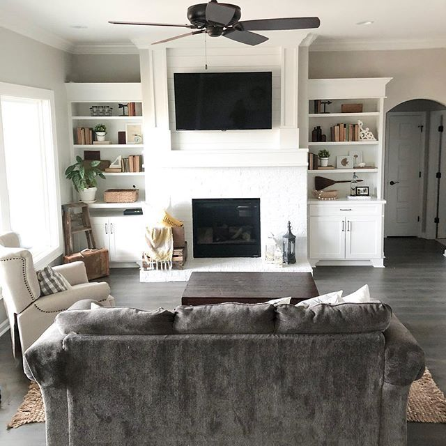 cozy farmhouse living room with painted brick fireplace ...