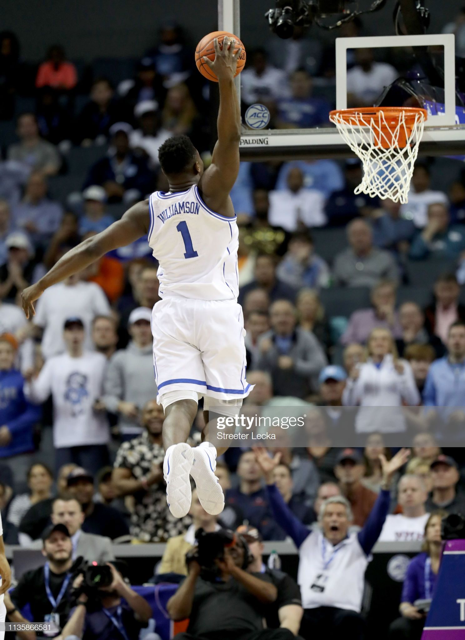 Zion Williamson of the Duke Blue Devils dunks his first