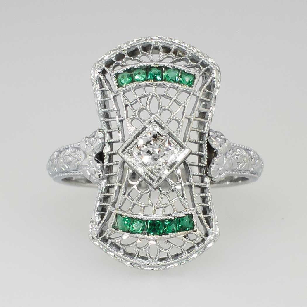 Elaborate .37ct t.w. Art Deco Old European Cut Diamond & Emerald Ring 18k | Antique & Estate Jewelry | Jewelry Finds Price: $750.00  What's not to love about this authentic Art Deco era (1930's) natural French cut emerald and old European cut diamond adorned filigree highly ornate cocktail ring?! It has such character and depth, a true vintage find! This ring features a central old European cut diamond weighing approximately .12cts