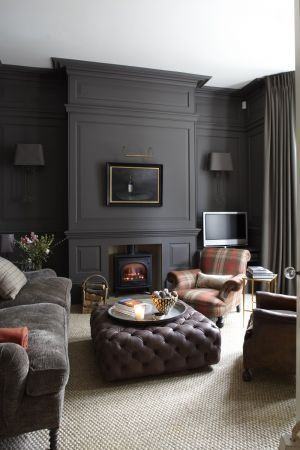 A Plaid Armchair Pairs With A Tufted Leather Ottoman And