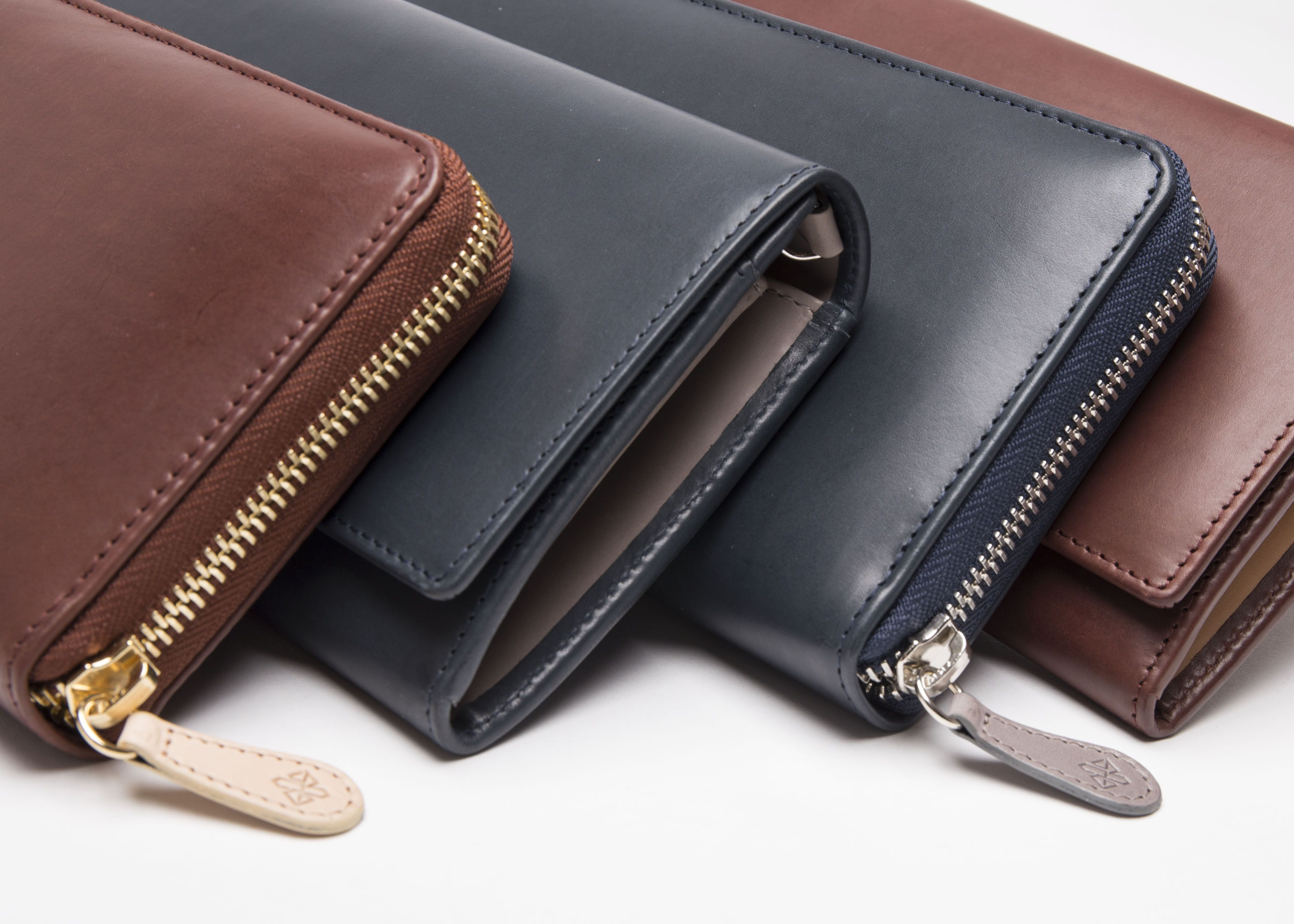 161008d67 Ettinger London - Luxury Leather Goods - Saint Crispin Collection -  Burnishable calf, silky soft leather. Purses in deep sea blue and bracken  brown.