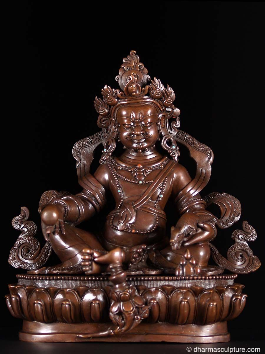 Kubera also known as Jambhala is the Buddhist god of wealth. In many depictions such as this one, the deity is shown as a plump figure wearing a crown, ribbons and jewelry, and holding a mongoose, representing his victory over the naga (snake deities), who symbolize greed. As God of Wealth, Kubera squeezes the mongoose and causes the creature to spew out jewels. This lost wax method statue was hand cast by the very talented artists of the beautiful country of Nepal. Every piece is truly…