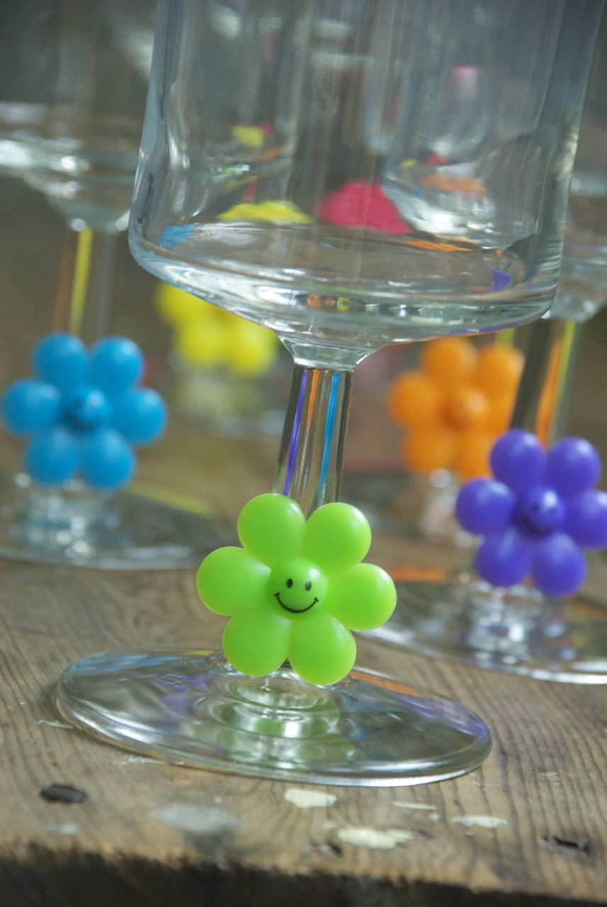 Happy Drink Markers. Grab a bag of plastic rings at a party supply store and slip them onto the stem of your glasses to link the glass to its owner.