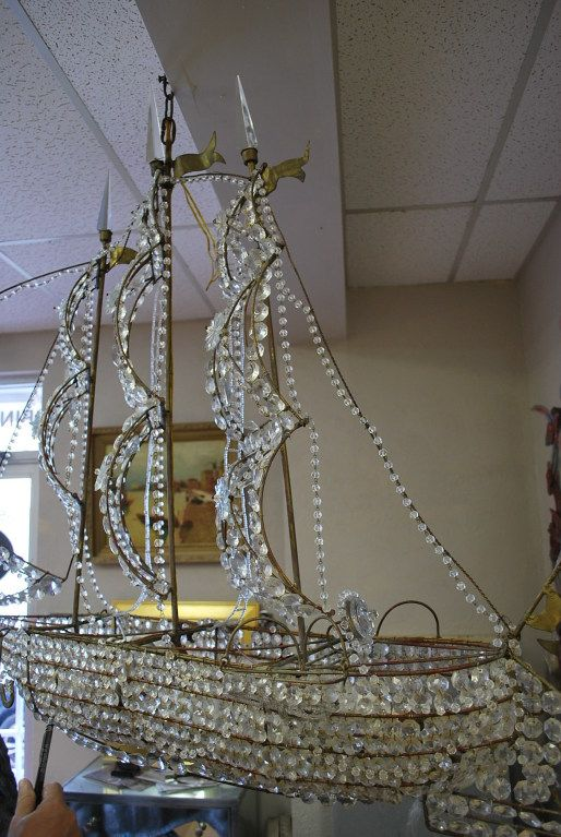 Crystal Ship Chandelier Down The Long Hallway Along With A Star