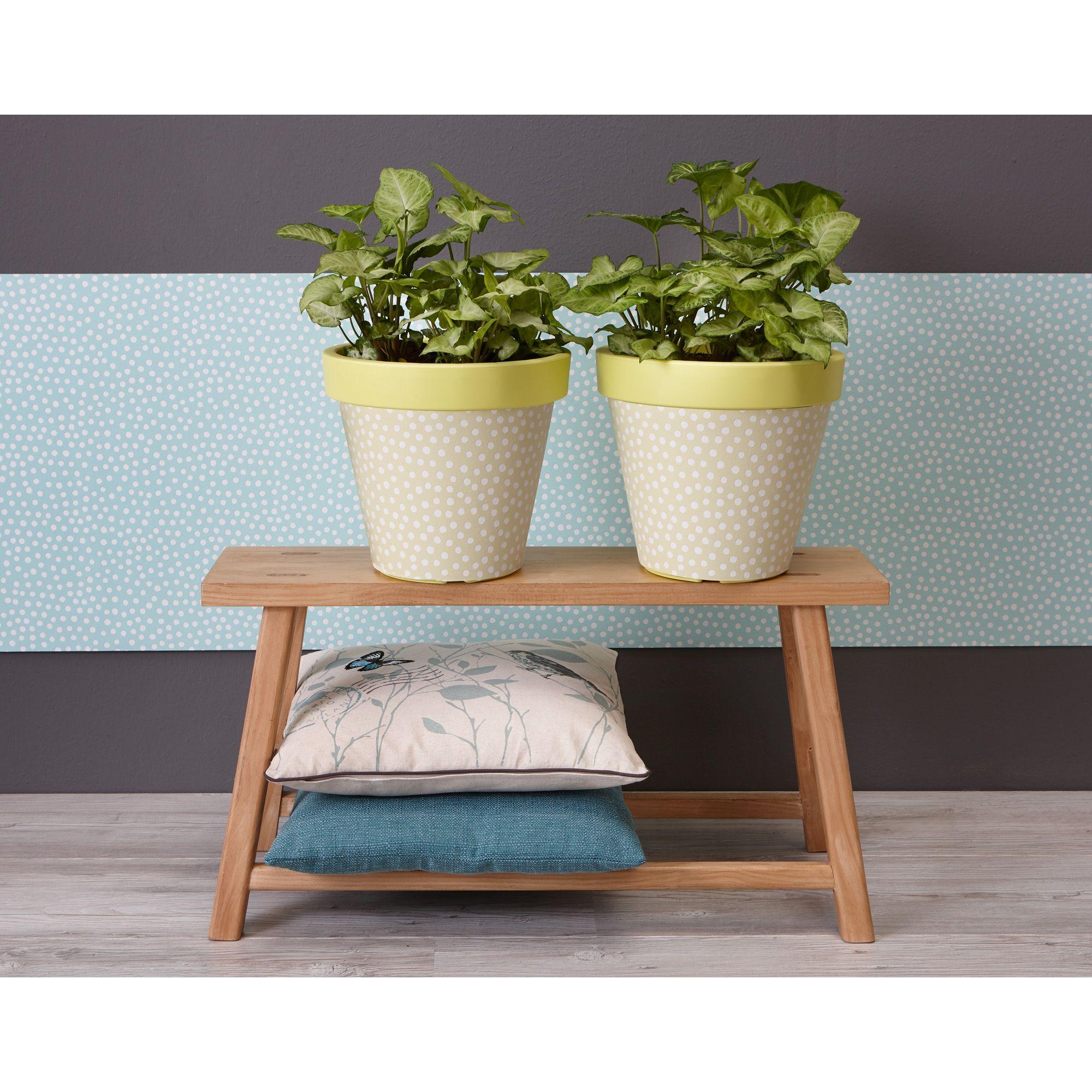 bloempotten staan ook hartstikke leuk in huis door ze op te leuken met behang maak