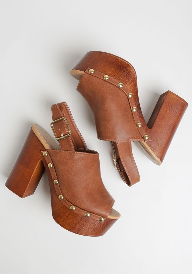 48e61ab2e0f The faux wood platform and chunky heel add height without losing comfort