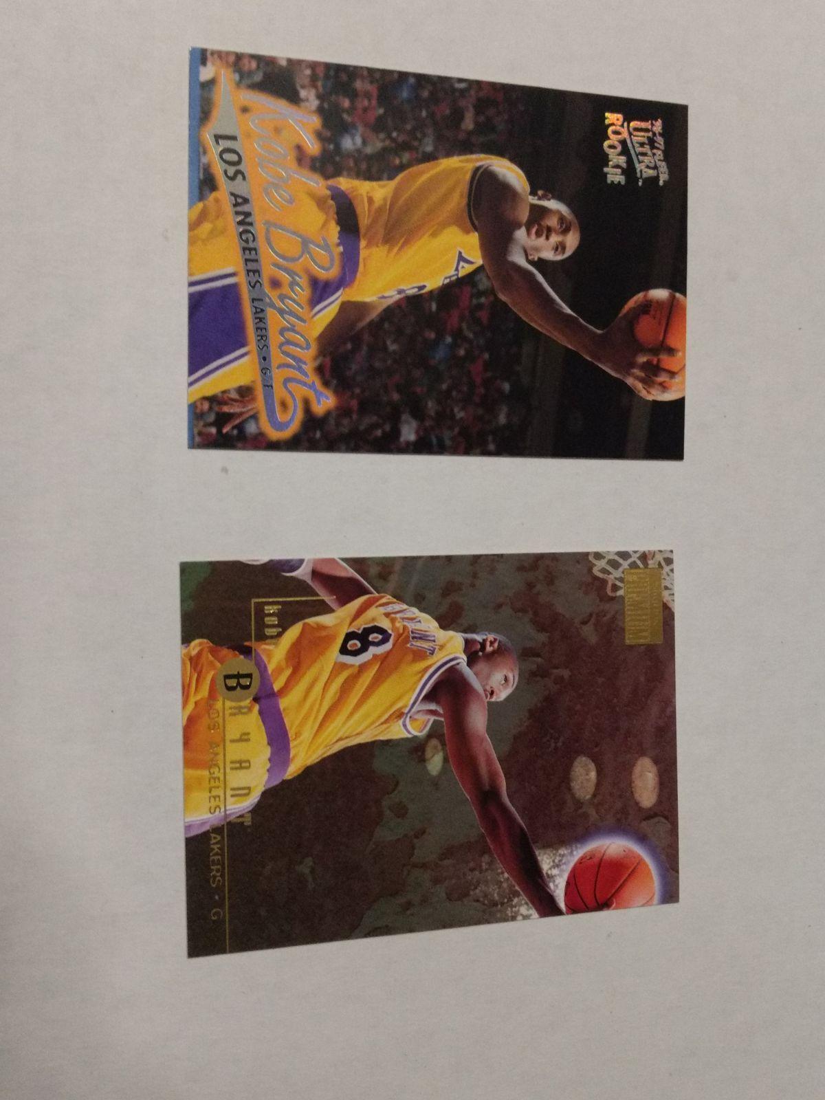 96 Fleer and Skybox Premium Kobe Bryant rookie cards. Both