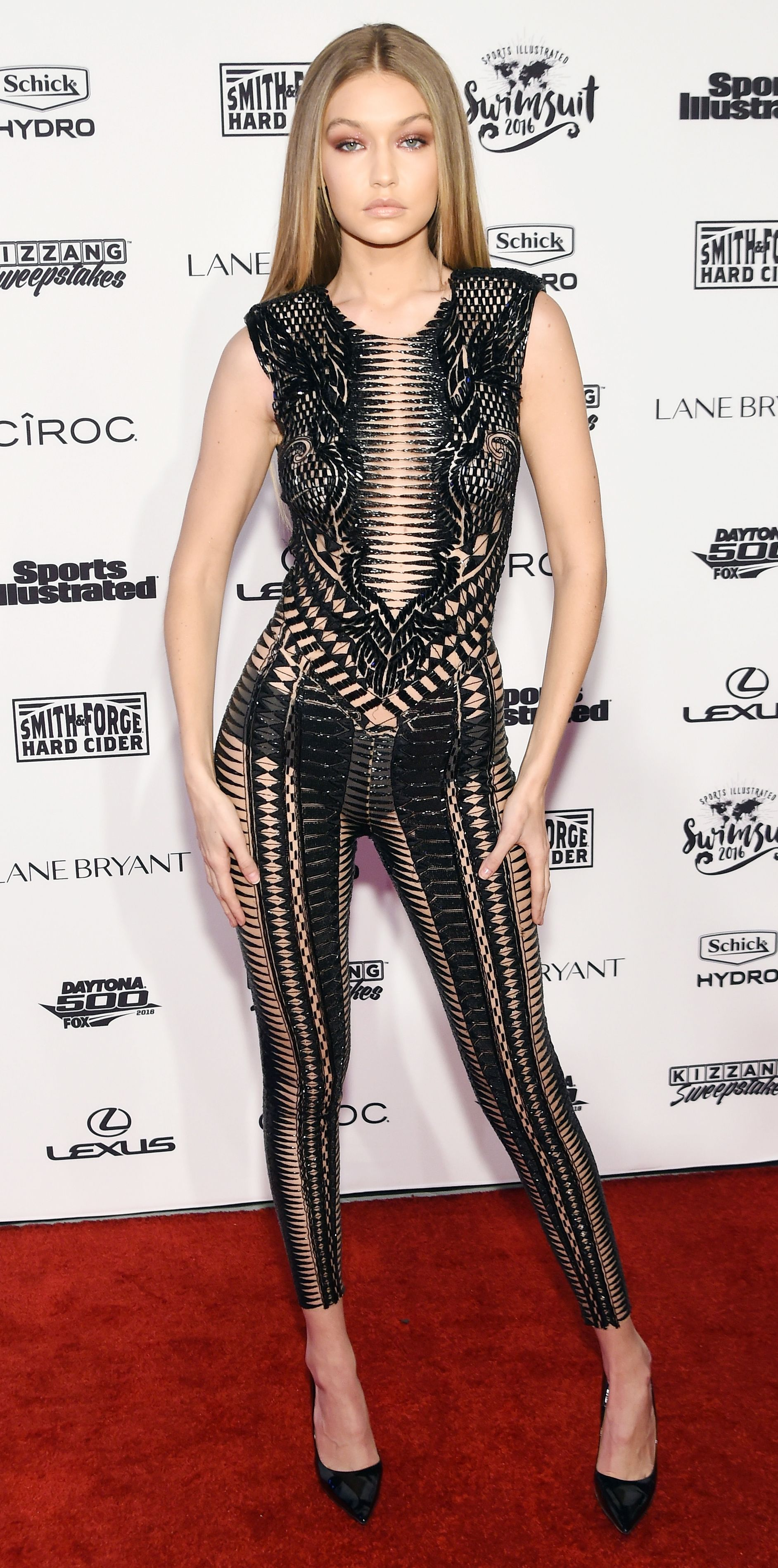 4a2aa4ee120 ... a commotion at the Sports Illustrated Swimsuit Issue Event in what  might be the sexiest jumpsuit ever—a black bead-embroidered sheer Julien  Macdonald ...