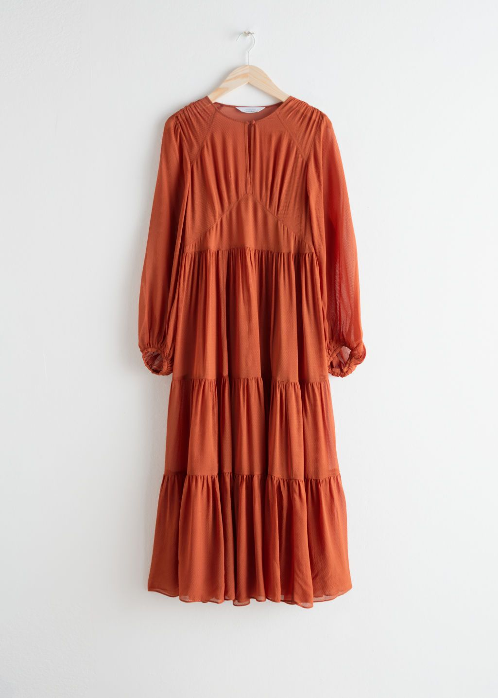 Front image of stories ruffle tier maxi dress in orange dream