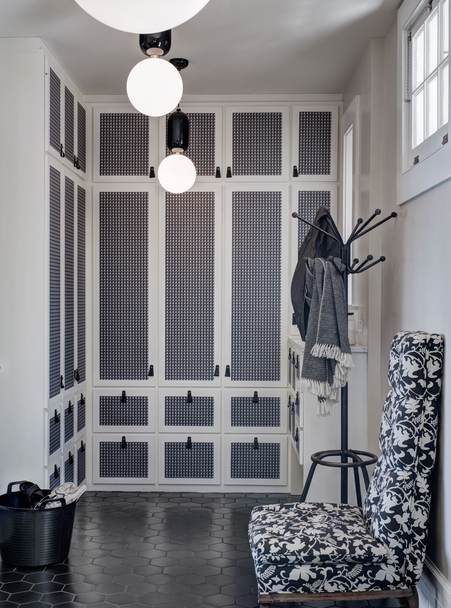 Mudroom, Black Tile Floor, Plaster Walls, Hermes Wallpaper, Leather Pulls