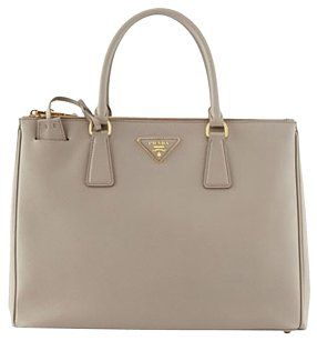 d0c756e5466 ... bag tradesy 64e2c bd2fc; authentic get one of the hottest styles of the  season the prada saffiano double zip executive