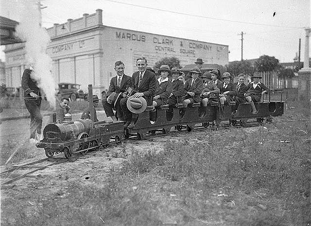 Fort Street schoolboys riding on a model steam train, Sydney, 1927 / Sam Hood. For more detailed information about this photograph: http://acms.sl.nsw.gov.au/item/itemDetailPaged.aspx?itemID=52340 From the collection of the State Library of New South Wales www.sl.nsw.gov.au