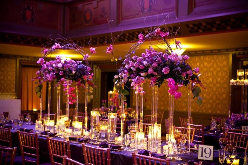 Exotic Purple Floral Decorations On Wedding Reception Table