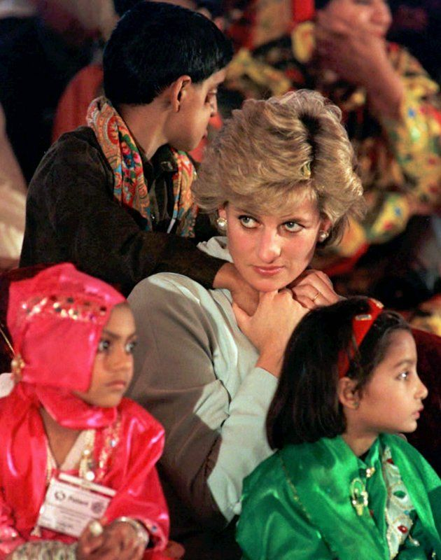 Britain's Princess of Wales sits with sick children, during a visit to the Shaukat Khanum Memorial Hospital, founded by Pakistani cricket star Imran Khan, ...