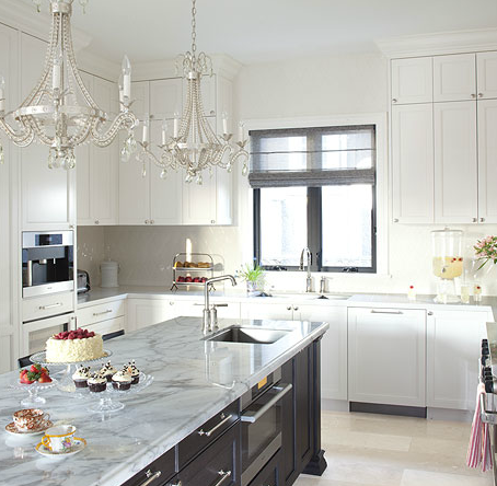 Lovely Kitchen With Crystal Chandeliers Over Brown Kitchen Island
