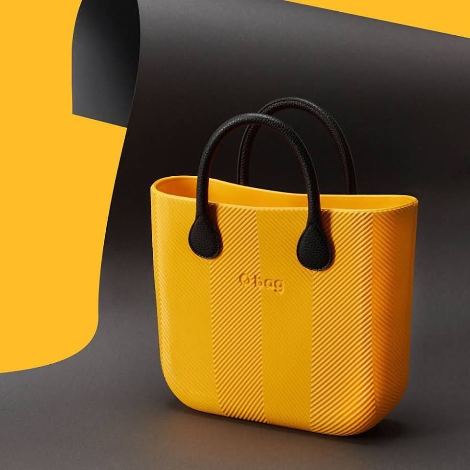 """Yellow mood on! Touch the new O bag mini#herringbone, a new texture of SS18 """"colors in new york"""" collection. Discover all the colors to our O bag stores. Soon available online. #Obag#yellowallert#taxicolor#Obaggoestonewyork#Obaglovesnewyork"""