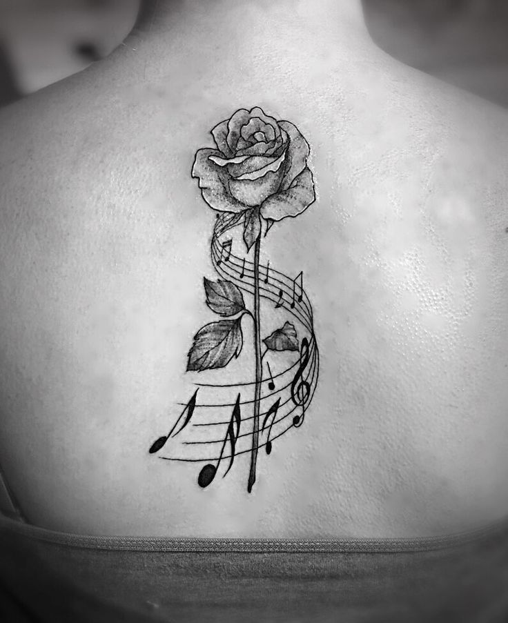 Photo of Rose and music note back tattoo #rose #staff #music #notes #back #tattoo,  #Inspirationaltatt…
