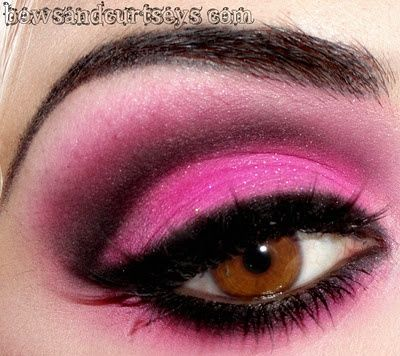 Neon bright pink and black dramatic eye make up