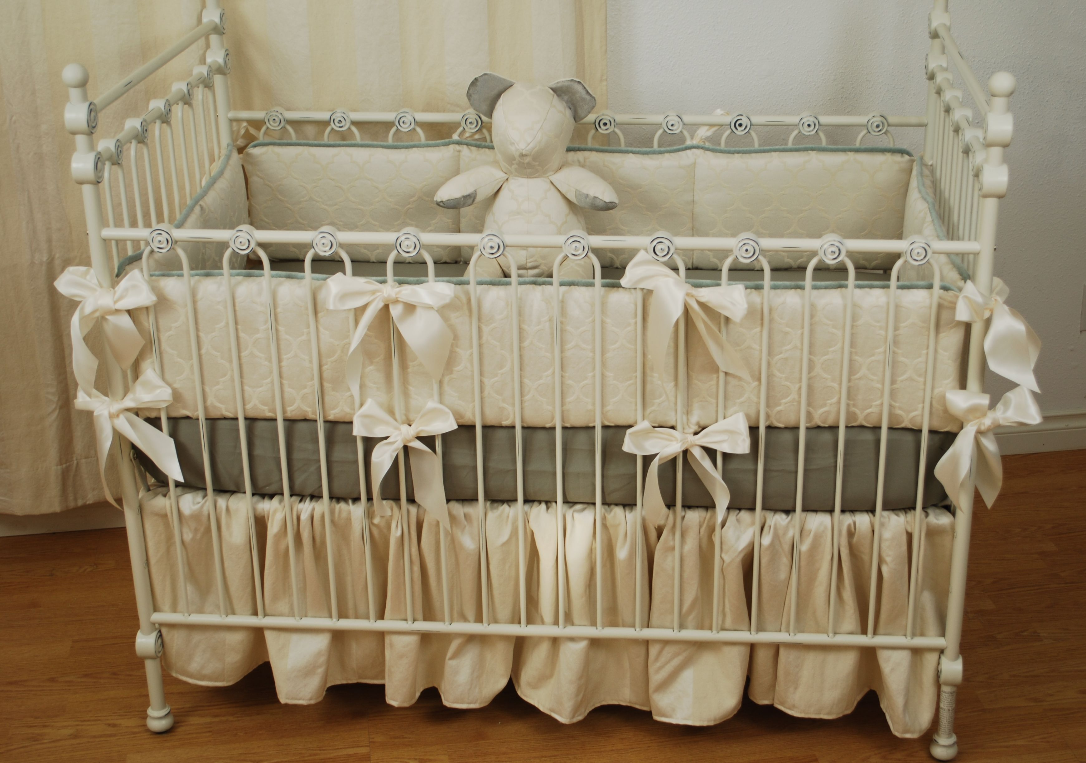 Ivory Quatrefoil Crib Bedding With A Grey Cotton Sheet And Velvet Ears On The