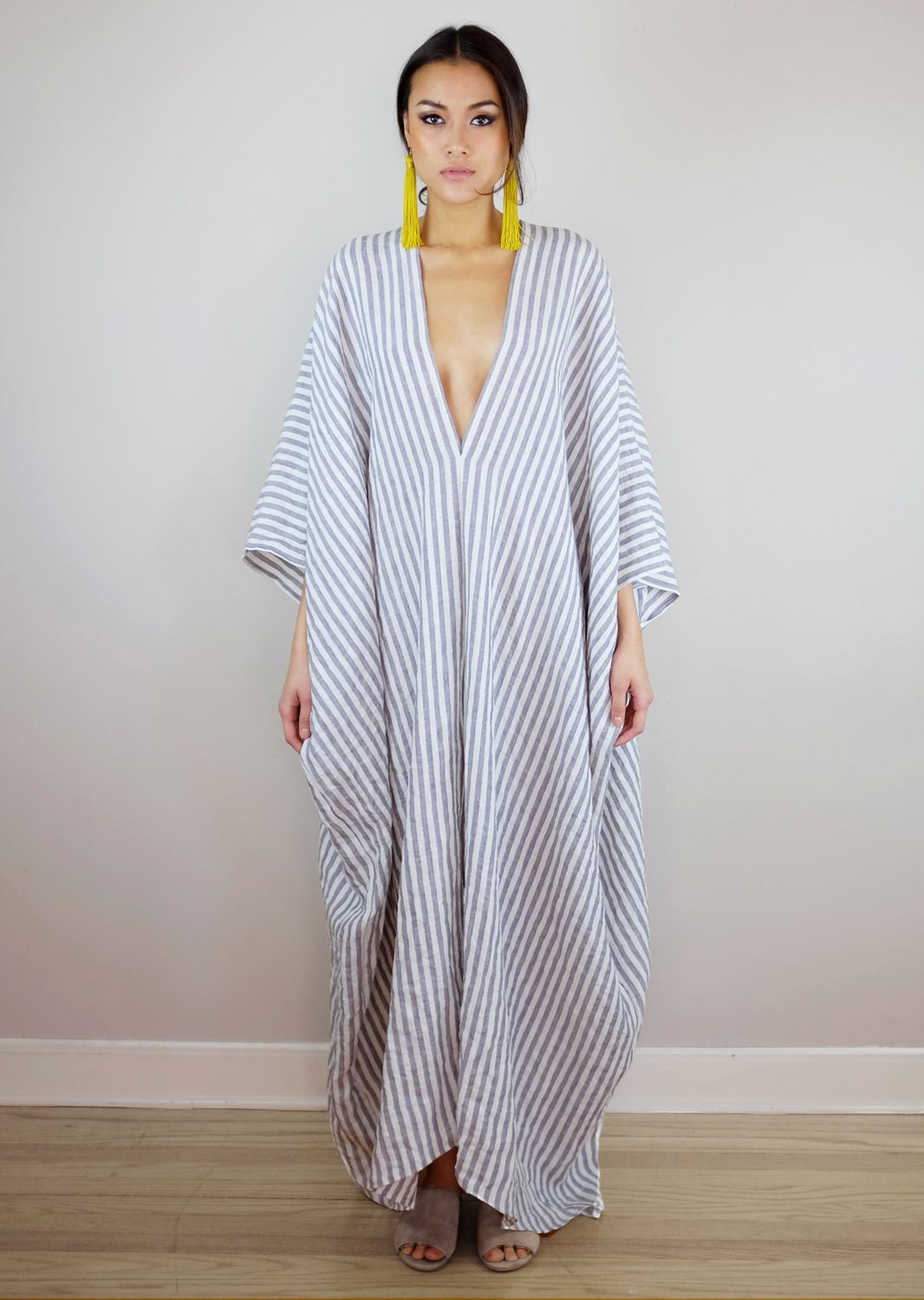 A relaxed, one size linen kaftan with deep v neckline and drop ...