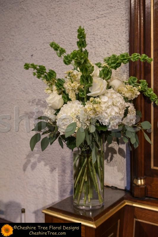 Tall Arrangements In Clear Glass Vases Created Using White Hydrangea