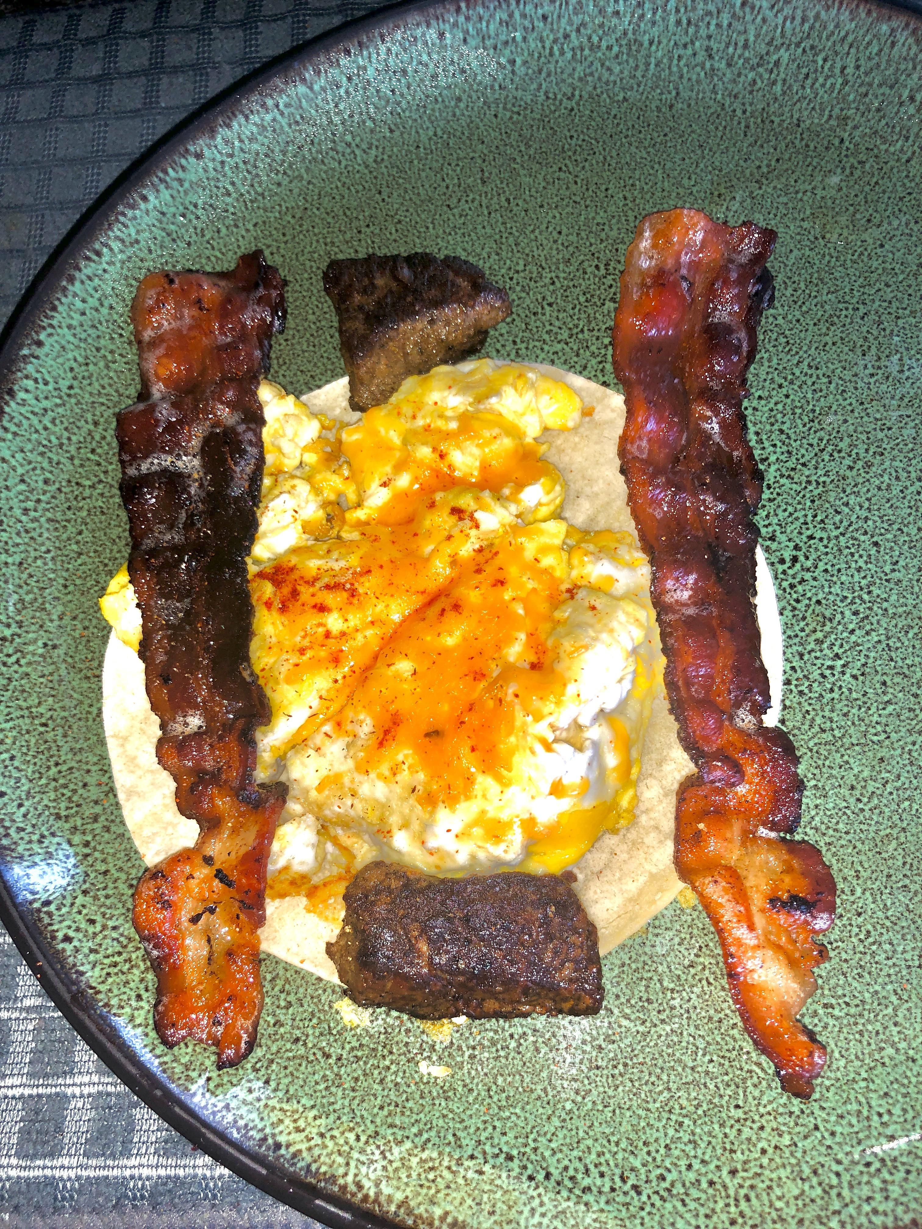 Made bacon with 2 small pieces of leftover steak with 2 scrammbled eggs with cheese and chilli / garlic seasoning on a toasted tortilla. YUMM! #food #healthy #healthyfood