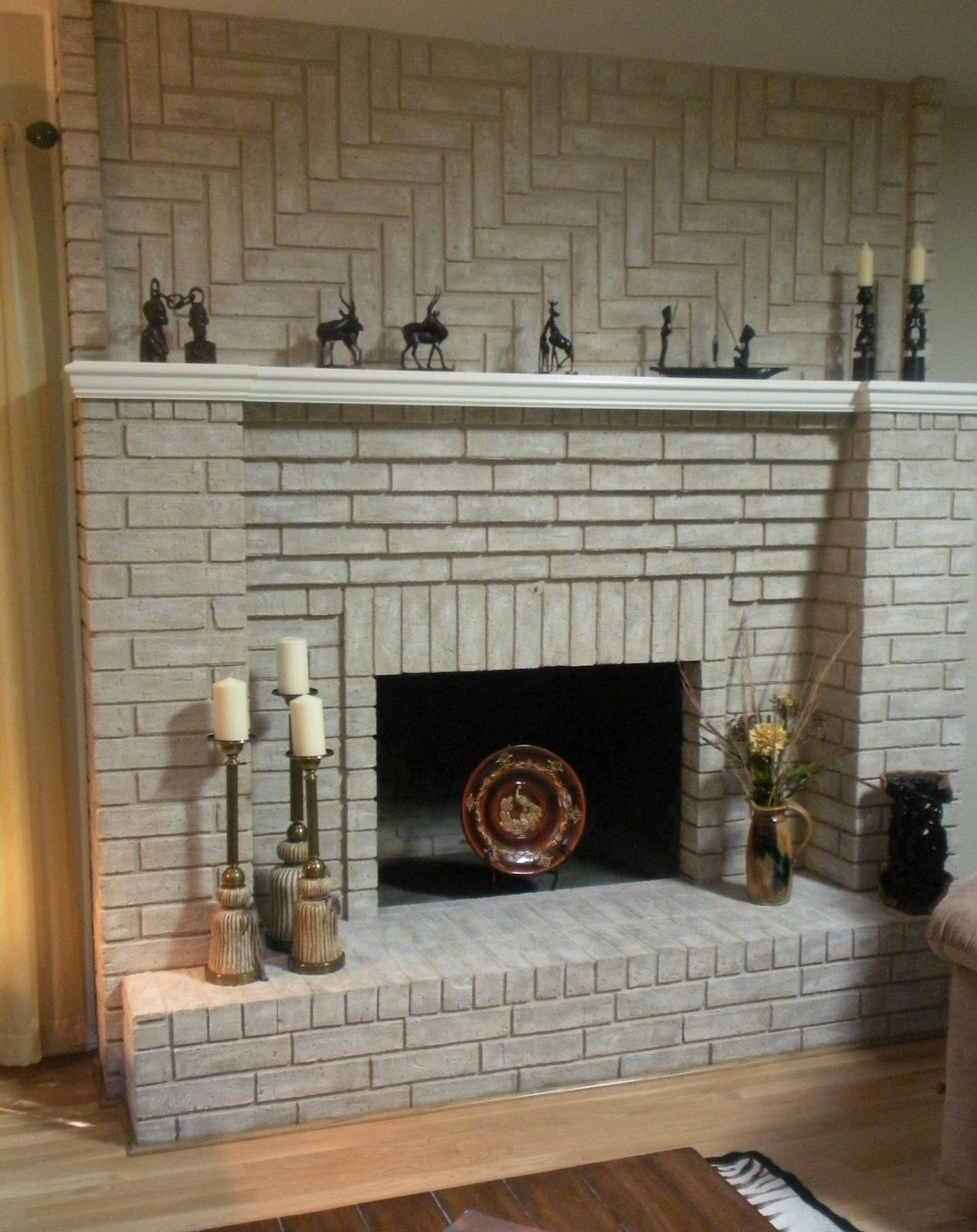 Update an older looking fireplace by painting it a chic white or