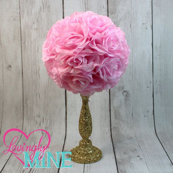 Centerpiece Pink Rose Pomander Glitter Gold Vase This listing is for 1 centerpiece, as pictured. The centerpiece is hand dipped in glitter gold (additional colors available in the drop down menu when adding to your cart) wood vase, topped with a silk faux rose ball pomander, additional colors also available. Lovingly Mine original design, perfect for any event! 17 inches Tall (approx.) 10 inch Diameter Rose Pomander…