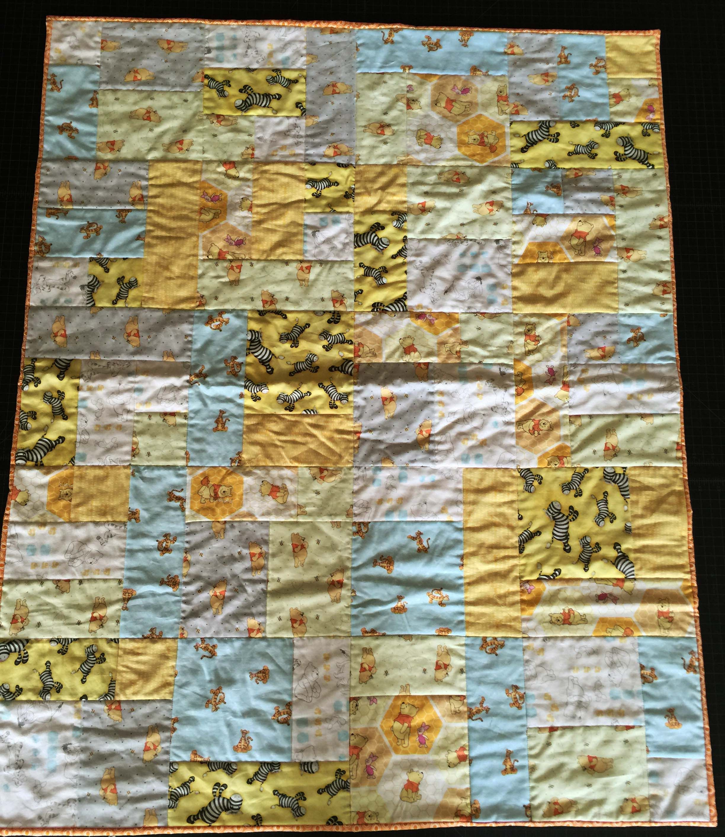 Infant Quilt, Winnie the Pooh- This is a quilt that I made for an expecting mother in a homeless shelter as part of a drive that my quilting guild is doing this fall, LAMQG. Piecing and Quilting by Greg Stewart, 09.2016