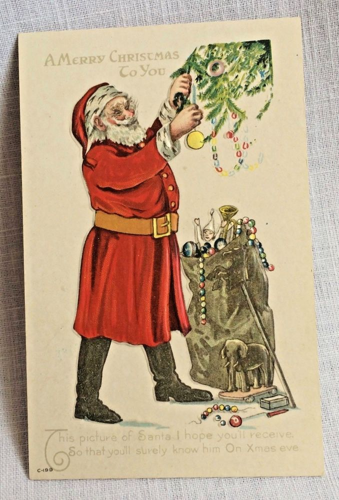 vintage christmas postcard santa brown in black boots trimming the