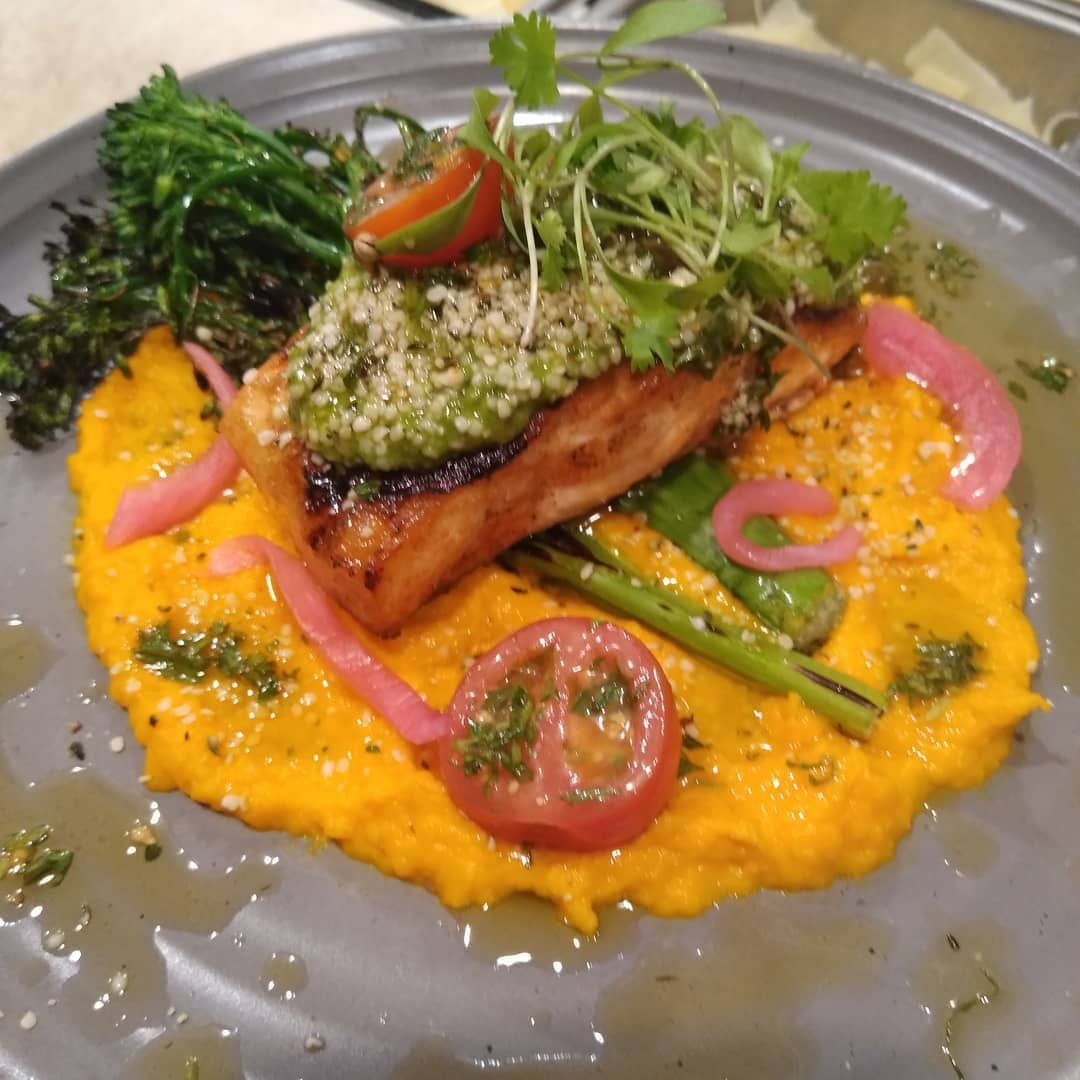 Grilled salmon, shishito pepper pesto,carrot puree, charged broccolini, fried polenta, tomato vin, hemp seeds #chefsofinstagram #chef #cooking #cheflife #cooklife #marthasvineyard #seafood #summer #sandiegostateofmind #sexdrugshautecuisine #truecoo