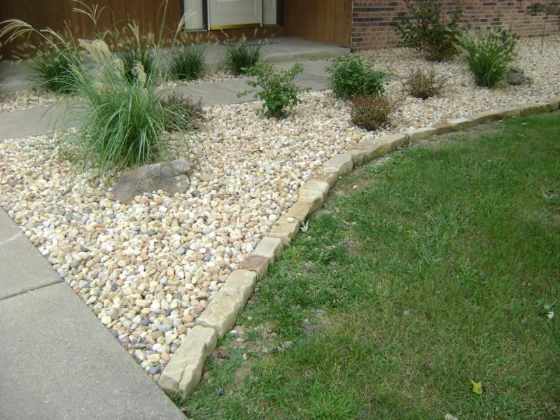 Stone edging for flower beds images of mulch for Red stone landscape rock