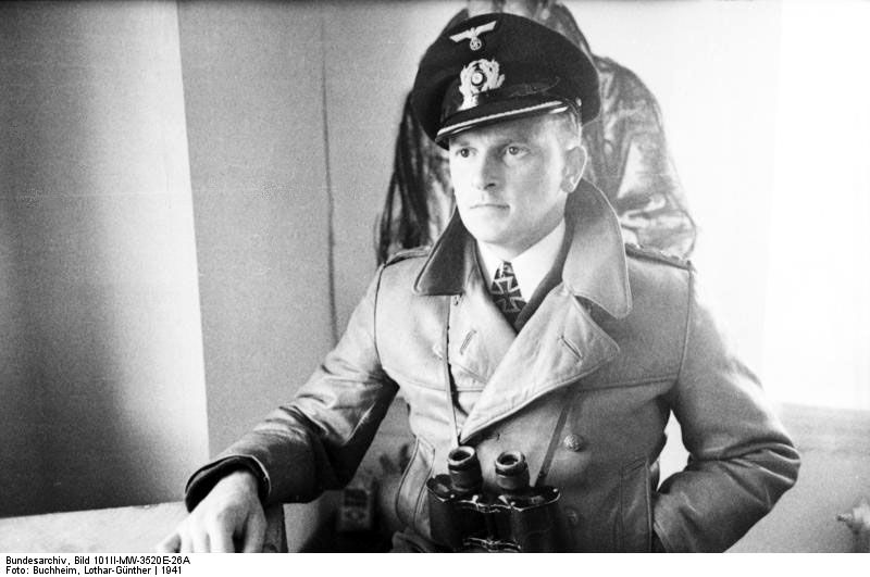 Captain Herbert Emil Schultze (1909-1987) was a German U-boat commander who commanded U-48 for eight patrols during the early part of the war, sinking 169,709 gross registered tons. He became famous on the Allied side for humanely broadcasting the positions of sinking ships so that rescuers could arrive. Between 1942 and the end of the war, he served in staff positions. After the war, he returned to service and retired in 1968. This 1941 photo is by Lothar-Günther Buchheim, who wrote DAS…
