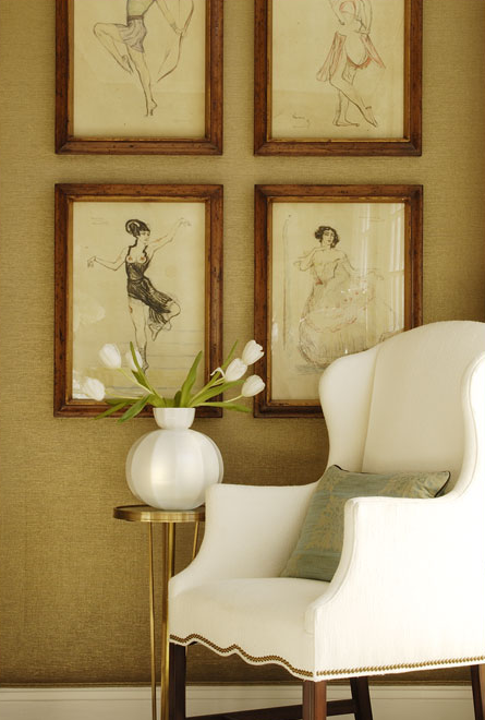 Beautiful Foyer Entrance Design With White Wingback Chair With Nailhead  Trim, Brass Accent Table, Wood Frames And Gold Textured Wallpaper.