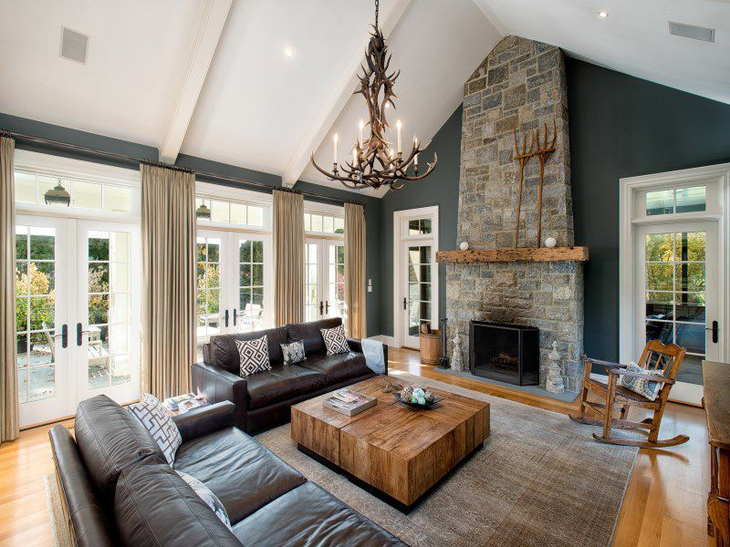 Rustic Living Room With Hardwood Floors Cathedral Ceiling Stone